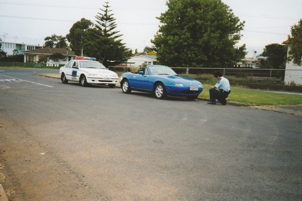YG8757 - 1991 Eunos Roadster Mazda MX5 with Ford Falcon New Zealand police car