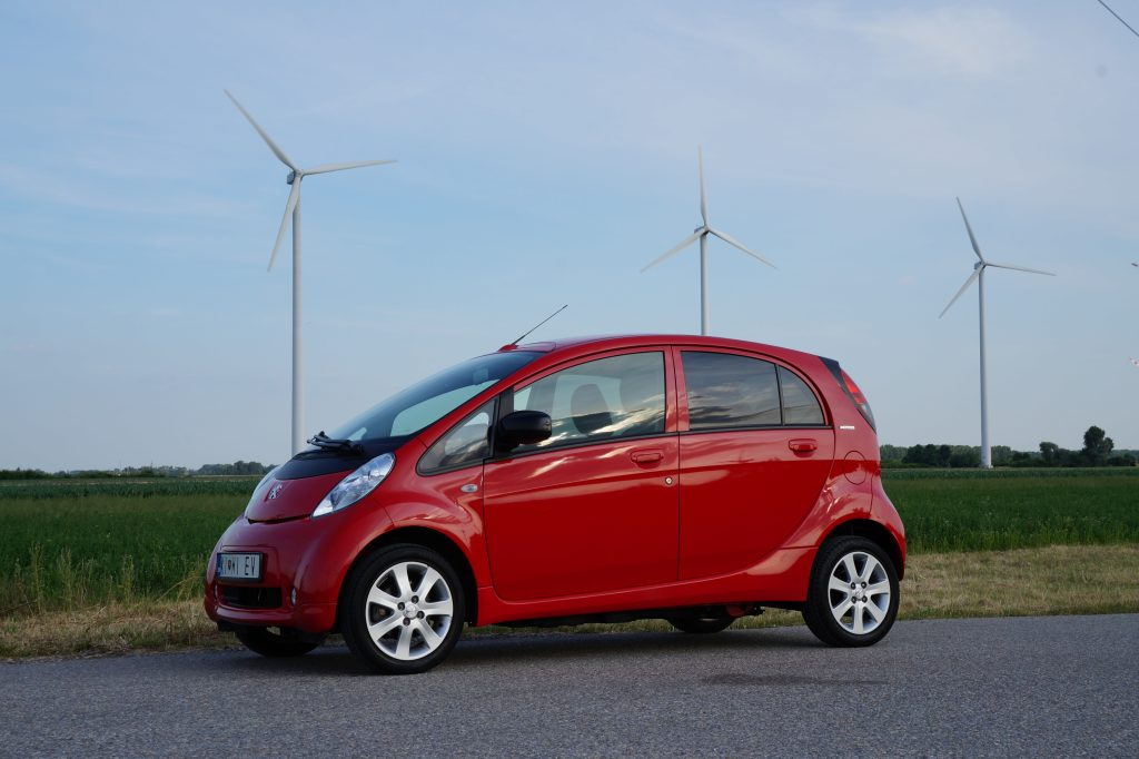 electric car in front of wind turbines royalty free public domain