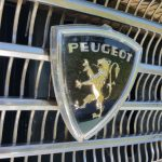 1970 Peugeot 404 badge on grille
