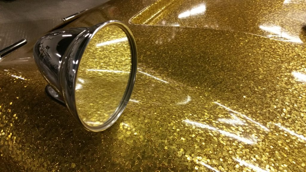 A close-up of the paint from Liberace's 1972 Bradley GT with gold metal flake finish