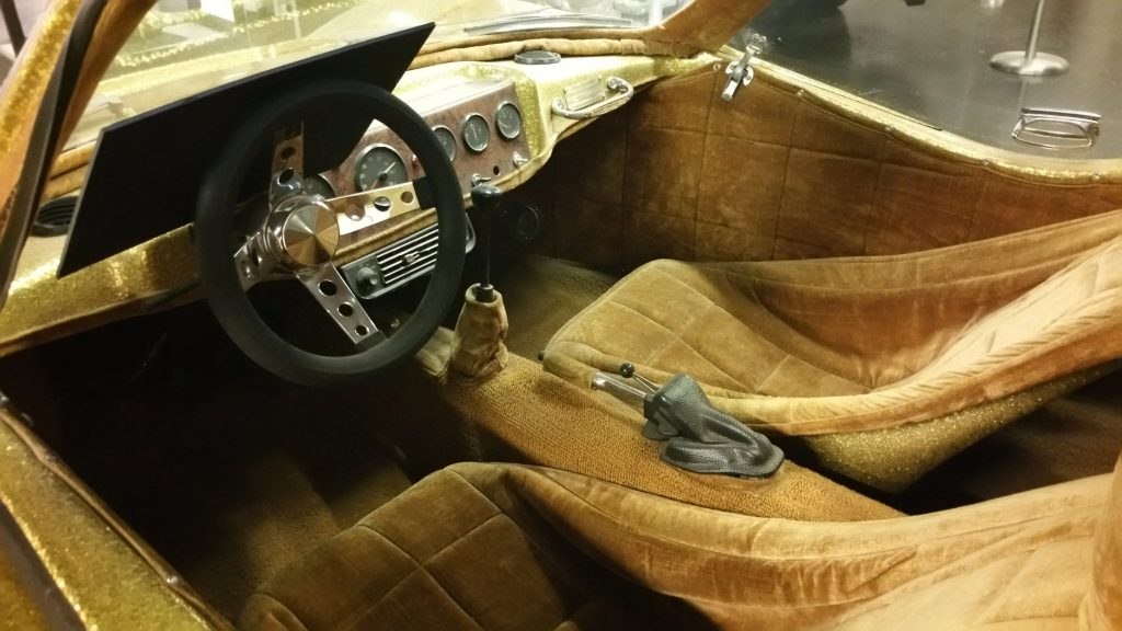 The interior of Liberace's 1972 Bradley GT with gold metal flake finish